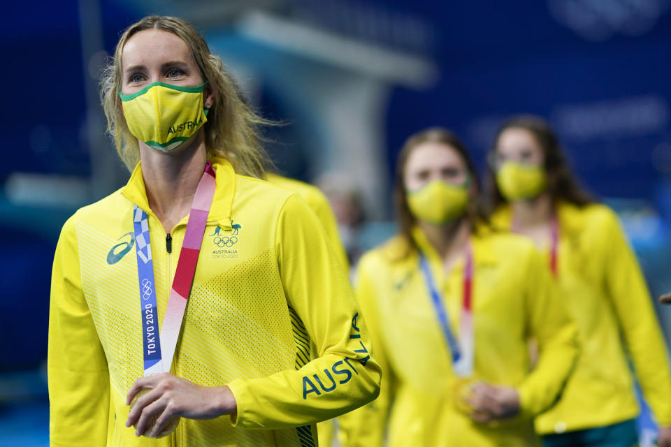 Emma Mckeon, of Australia, holds the gold medal for the women's 4x100-meter medley relay at the 2020 Summer Olympics, Sunday, Aug. 1, 2021, in Tokyo, Japan. (AP Photo/David Goldman)