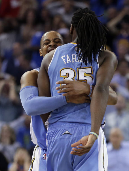 Denver Nuggets' Kenneth Faried (35) is embraced by Randy Foye after Faried made the game-winning shot against the Golden State Warriors during the second half of an NBA basketball game Thursday, April 10, 2014, in Oakland, Calif. Denver won 100-99. (AP Photo/Ben Margot)