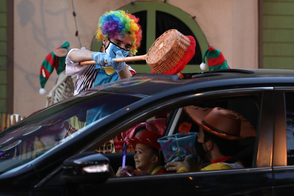 Performer AJ Danna pours candy through a sunroof at Haunt O' Tween LA. in Woodland Hills.