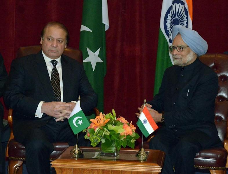 This photo released by the embassy of Pakistan shows Pakistan Prime Minister Nawaz Sharif, left, and Indian Prime Minister Manmohan Singh, right, during a meeting Sunday Sept. 29, 2013 in New York. The prime ministers met in a step toward easing tension, agreed on the need to stop the recent spate of attacks in the disputed Kashmir region. (AP Photo/Embassy of Pakistan)