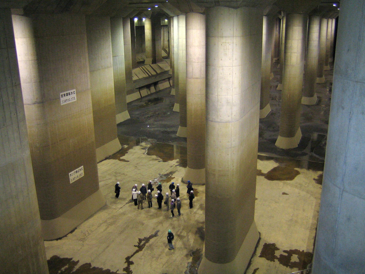 Visitors look at the pressure-controlled water tank at the Metropolitan  Area Outer Underground Discharge Channel in Kusakabe, north of Tokyo.<br><br>(Photo: REUTERS/Ministry of Land, Infrastructure, Transport and Tourism-Edogawa  River Office/Handout)