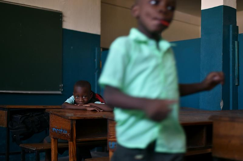 Haitian law sets the fee for public schooling at 1,000 gourdes ($16) a year, but the cost of a uniform, shoes and school supplies is simply beyond the reach of many parents (AFP Photo/HECTOR RETAMAL)