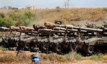 Israeli tanks are pictured at their position along the border with the Palestinian Gaza Strip on May 15