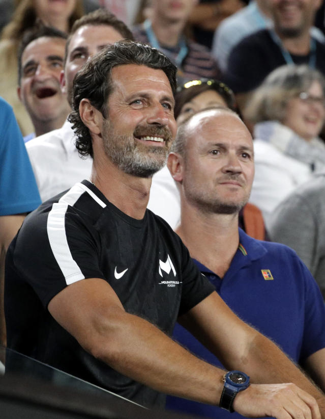 Patrick Mouratoglou smiles after watching Greece's Stefanos Tsitsipas defeat Switzerland's Roger Federer in their fourth round match at the Australian Open tennis championships in Melbourne, Australia, Sunday, Jan. 20, 2019. (AP Photo/Mark Schiefelbein)