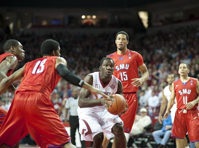 Arkansas' Alandise Harris looks to shoot the ball over SMU's defense during the first half of an NCAA college basketball game in Fayetteville, Ark., Monday, Nov. 18, 2013. (AP Photo/Sarah Bentham)