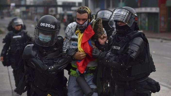 Protesters clash with ESMAD members on April 29, 2021, on the second day of protests against tax reform proposed by the Ivan Duque government in Cali, Colombia