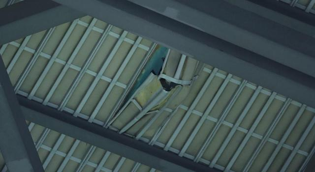 A hole in the roof of the Rogers Centre after falling ice caused chaos on Monday. (Tom Szczerbowski/Getty Images)