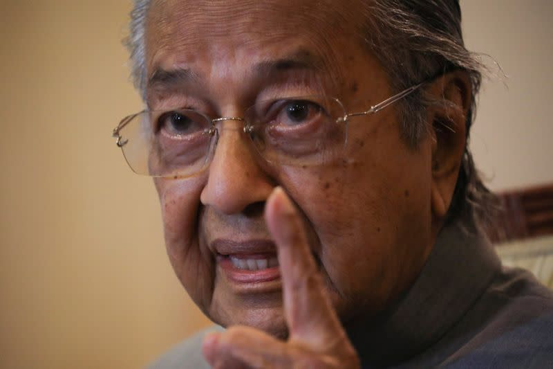 Malaysia's former Prime Minister Mahathir Mohamad speaks during a news conference in Putrajaya