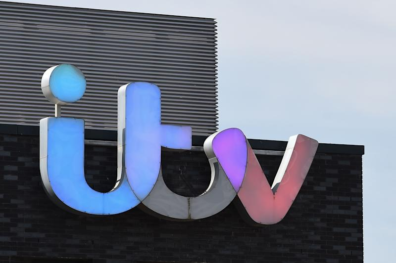 """A picture shows the logo of broadcaster ITV at their MediaCityUK studios in Salford, Greater Manchester, northwest England, on May 14, 2019. - All episodes of a popular British talk show have been pulled from the internet and filming has been suspended after the reported suicide of a former guest Tuesday. Broadcaster ITV pulled its most popular daytime show """"The Jeremy Kyle Show"""" off air indefinitely following the death of 63-year-old Steve Dymond, a week after he appeared on an episode. (Photo by Paul ELLIS / AFP) (Photo credit should read PAUL ELLIS/AFP/Getty Images)"""