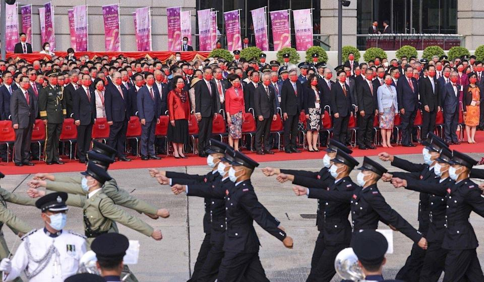 Security officers march past local and Beijing officials on hand for Friday's National Day ceremony in Wan Chai. Photo: Dickson Lee