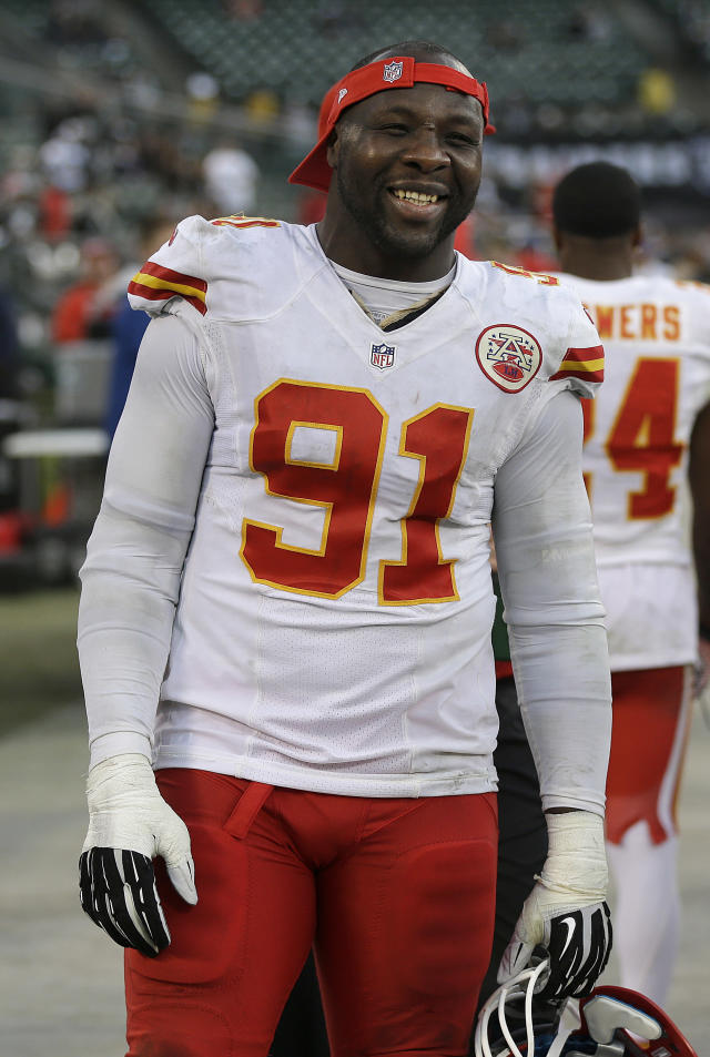 Kansas City Chiefs outside linebacker Tamba Hali (91) stands on the sideline during the fourth quarter of an NFL football game against the Oakland Raiders in Oakland, Calif., Sunday, Dec. 15, 2013. (AP Photo/Marcio Jose Sanchez)