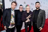 <p>While each guy in the band clearly has his own look, they share a common bond of undercuts and colorful hair dye. (And it looks like one of their shirts may or may not have been used for cleanup.) <i> (Photo: Getty Images)</i></p>