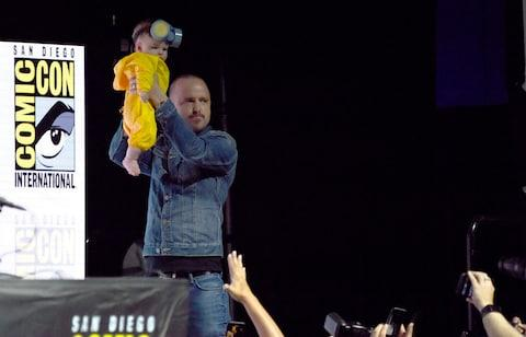 Aaron Paul holds his daughter Story Annabelle in the air as she is dressed as his character Jesse Pinkman