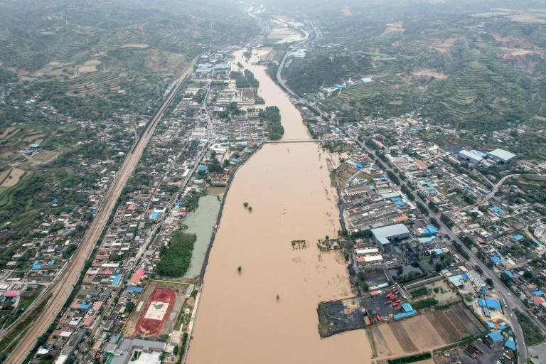 There has been unseasonably heavy rain and flooding in north China's Shanxi province (AFP/STR)