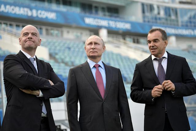 Russian President Vladimir Putin (C), FIFA President Gianni Infantino (L) and Governor of the Krasnodar Region Veniamin Kondratyev visit the Fisht Stadium, which will host matches of the 2018 FIFA World Cup in Sochi, Russia May 3, 2018. Sputnik/Aleksey Nikolskyi/Kremlin via REUTERS ATTENTION EDITORS - THIS IMAGE WAS PROVIDED BY A THIRD PARTY.