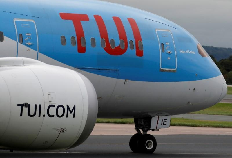 FILE PHOTO: A TUI jet prepares to take off from Manchester Airport