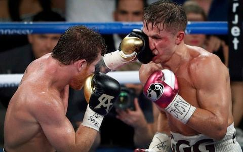 Canelo lands a punch on GGG - Credit: Las Vegas Sun
