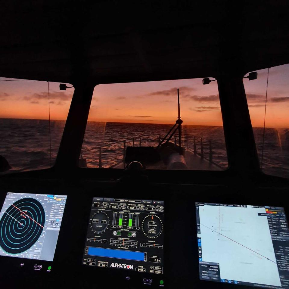 This July 2021 photo provided by Sea Shepherd shows the view from the bridge of the Ocean Warrior at sunset. Under a United Nations maritime treaty, to which China is a signatory, large ships are required to continuously use what's known as an automated identification system, or AIS, to avoid collisions. Switching it off, except in cases of an imminent threat, for example hiding from pirates, is a major breach that should lead to sanctions for a vessel and its owner under the law of the nation to which it is flagged. (Peter Hammarstedt/Sea Shepherd via AP)