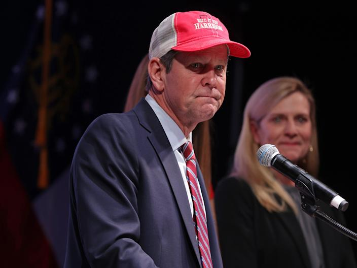<p>Georgia Gov. Brian Kemp speaks as his wife Marty Kemp looks on during a run-off election night party at Grand Hyatt Hotel in Buckhead on 5 January 2021 in Atlanta, Georgia</p> ((Getty Images))