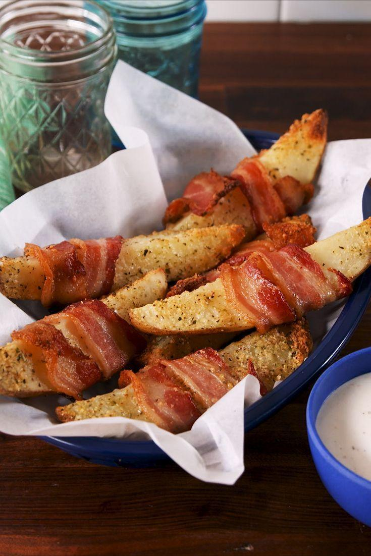 """<p>AKA heaven wrapped potato wedges. </p><p>Get the <a href=""""https://www.delish.com/uk/cooking/recipes/a33400452/bacon-wrapped-parmesan-potatoes-recipe/"""" rel=""""nofollow noopener"""" target=""""_blank"""" data-ylk=""""slk:Bacon-Wrapped Parmesan Potatoes"""" class=""""link rapid-noclick-resp"""">Bacon-Wrapped Parmesan Potatoes</a> recipe.</p>"""