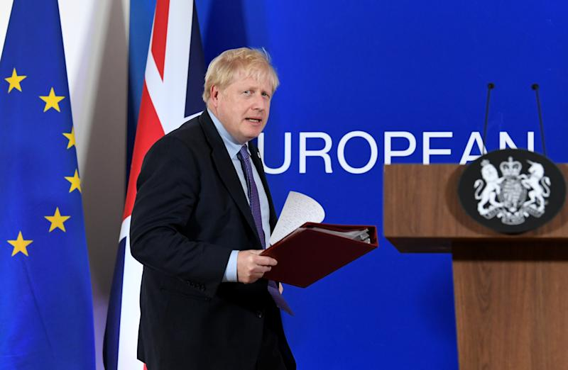 Britain's Prime Minister Boris Johnson arrives to speak at a news conference during the European Union leaders summit dominated by Brexit, in Brussels, Belgium October 17, 2019. REUTERS/Piroschka van de Wouw