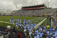 FILE - In this Sept. 26, 2020, file photo, Mississippi players take the field before an NCAA college football game against Florida in Oxford, Miss. Southeastern Conference football is trying to get back to normal, with filled-up stadiums and fired-up grills outside. The SEC will fully reopen for business this weekend, with 11 of the 14 teams hosting games after a season of shrunken crowds and no on-campus tailgating in states where fall Saturdays are all about college football. (AP Photo/Thomas Graning, File)