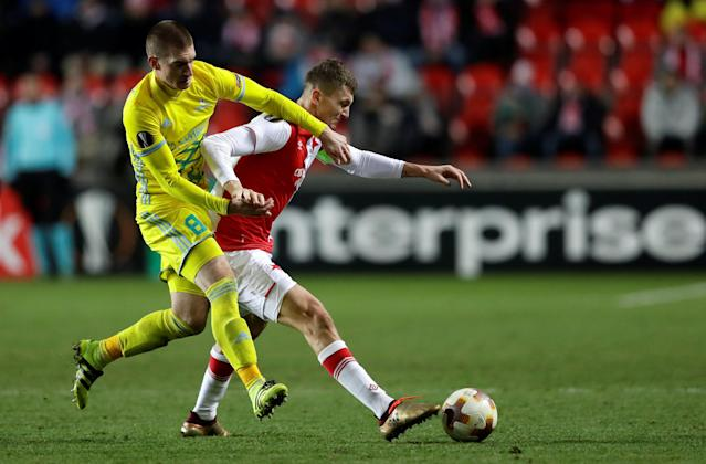 Soccer Football - Europa League - Slavia Prague vs Astana - Eden Arena, Prague, Czech Republic - December 7, 2017 Astana's Srdan Grahovac in action with Slavia Prague's Jaromir Zmrhal REUTERS/David W Cerny