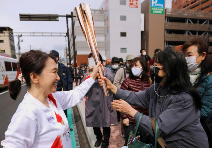 FILE PHOTO: Second day of the Tokyo 2020 Olympic torch relay in Fukushima prefecture, Japan