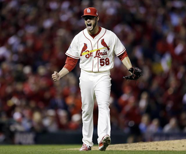 St. Louis Cardinals starting pitcher Joe Kelly reacts after getting Boston Red Sox's Daniel Nava to strike out and end the top of the fourth inning of Game 3 of baseball's World Series Saturday, Oct. 26, 2013, in St. Louis. (AP Photo/Jeff Roberson)