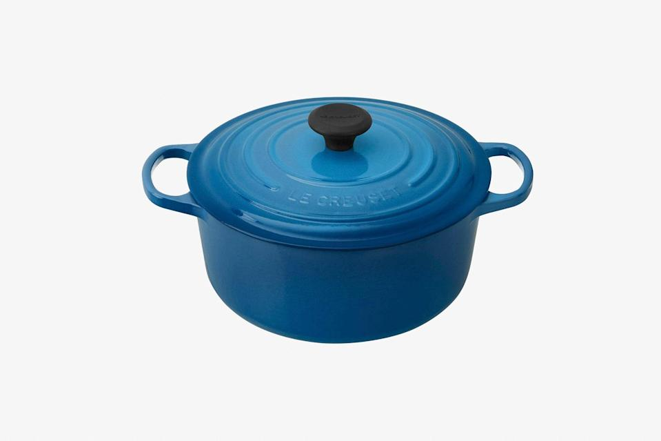 """A piece of Le Creuset cookware is a statement piece for anyone's kitchen—but even more so if they're that person who visited France once and came back thinking they were the next <a href=""""https://www.cntraveler.com/story/you-can-now-learn-to-cook-at-julia-childs-provencal-home?mbid=synd_yahoo_rss"""" rel=""""nofollow noopener"""" target=""""_blank"""" data-ylk=""""slk:Julia Child"""" class=""""link rapid-noclick-resp"""">Julia Child</a>. This classic cast-iron Dutch oven comes in an array of colors with fun names like Truffle, Marseille, and Palm, and is perfect for cooking, say, a rich cassoulet at your next dinner party. Not that you have to stick to French cooking, though. In need of some recipe inspiration? Look no further than this list of <a href=""""https://www.cntraveler.com/story/best-travel-cookbooks?mbid=synd_yahoo_rss"""" rel=""""nofollow noopener"""" target=""""_blank"""" data-ylk=""""slk:our favorite cookbooks"""" class=""""link rapid-noclick-resp"""">our favorite cookbooks</a>. $324, Amazon. <a href=""""https://www.amazon.com/Creuset-Signature-Enameled-Cast-Iron-Marseille/dp/B0076NOHM6"""" rel=""""nofollow noopener"""" target=""""_blank"""" data-ylk=""""slk:Get it now!"""" class=""""link rapid-noclick-resp"""">Get it now!</a>"""