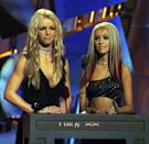 Crimped hair, dark shadow, red streaks, and metallic frosted lips? Britney Spears and Christina Aguilera managed to wear <em>all</em> the trends in 2000.