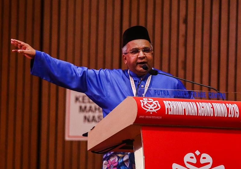 Bukit Gelugor division chief Datuk Omar Faudzar speaks during the Umno Annual General Assembly in Kuala Lumpur December 7, 2019. — Picture by Firdaus Latif