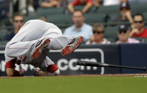 Cincinnati Reds' Joey Votto hits the ground as he dives to avoid being hit by a pitch in the first inning of a baseball game against the Atlanta Braves, Sunday, July 14, 2013, in Atlanta. (AP Photo/John Bazemore)