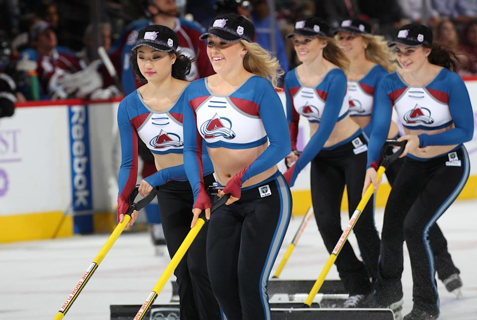 <p>Members of the of the Colorado Avalanche ice girls clean the ice during a break in the action at the Pepsi Center on November 3, 2015 in Denver, Colorado. The Avalanche defeated the Flames 6-3. (Photo by Michael Martin/NHLI via Getty Images) </p>
