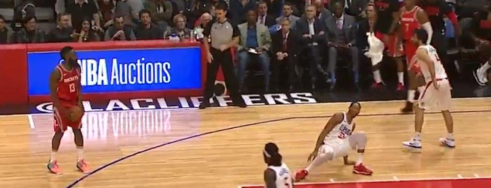 James Harden looks down on his works while Wesley Johnson despairs. (Screencap via NBA)