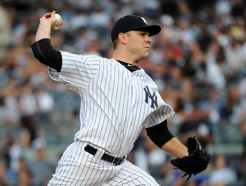 Ellsbury, Phelps lead Yankees to 4-3 win over Reds