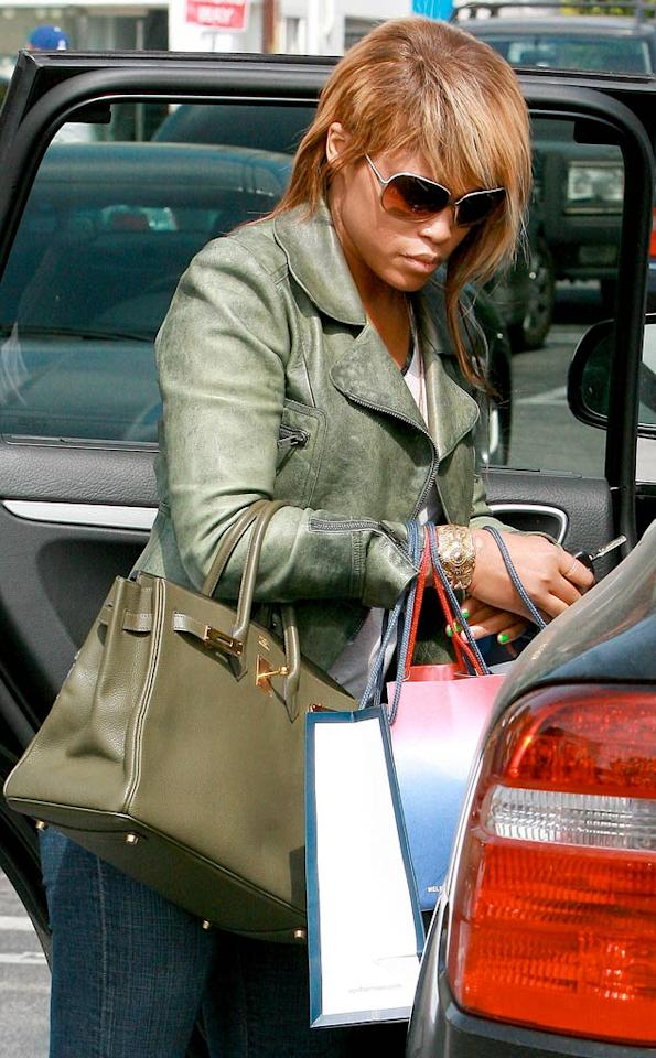 """Rapper Eve showed off her """"femullet"""" -- or female mullet -- while shopping in Santa Monica Tuesday. <a href=""""http://www.x17online.com"""" target=""""new"""">X17 Online</a> - April 28, 2009"""