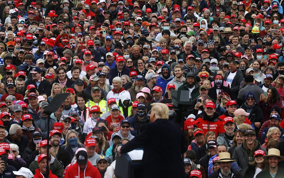 President Donald Trump speaks to manly maskless supporters at a campaign event, in Lititz, Pennsylvania on October 26, 2020. (Leah Millis/Reuters)
