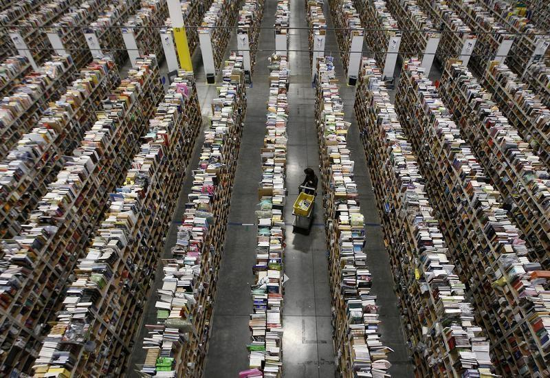 Worker gathers items for delivery at Amazon's distribution center in Phoenix