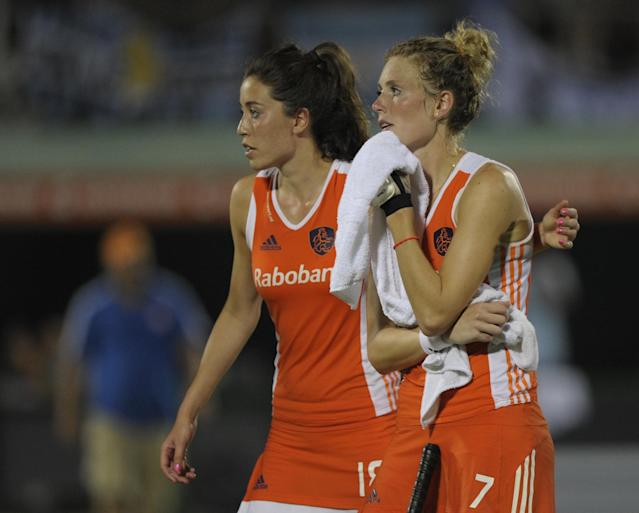 Netherlands' Willemijn Bos (R) and Naomi Van As react after losing in a penalty shoot-out against Argentina their Champions Trophy 2012 semifinal field hockey match in Rosario, Santa Fe, Argentina, on February 4, 2012. Argentina defeated Netherlands and will face England on the final on February 5. AFP PHOTO / Juan Mabromata (Photo credit should read JUAN MABROMATA/AFP/Getty Images)