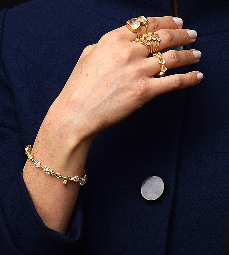 The Duchess of Sussex demonstrated her fashion know-how with stacks of rings at Princess Eugenie's wedding [Photo: Getty]