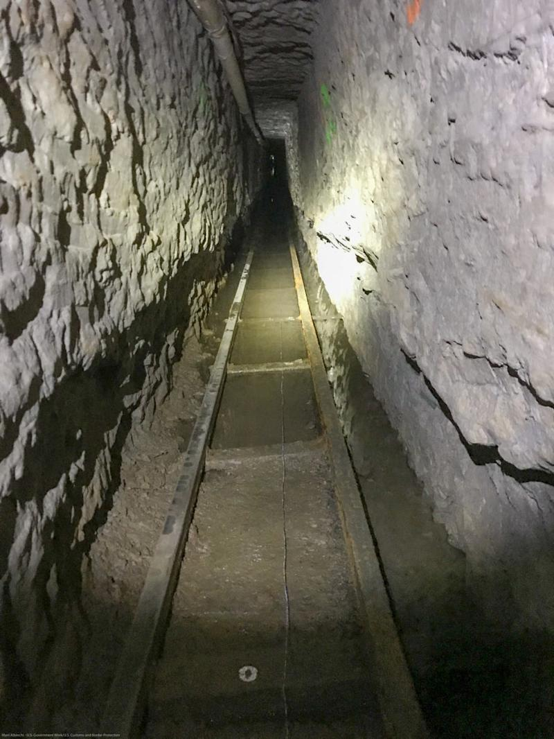 The tunnel includes an extensive rail and cart system.