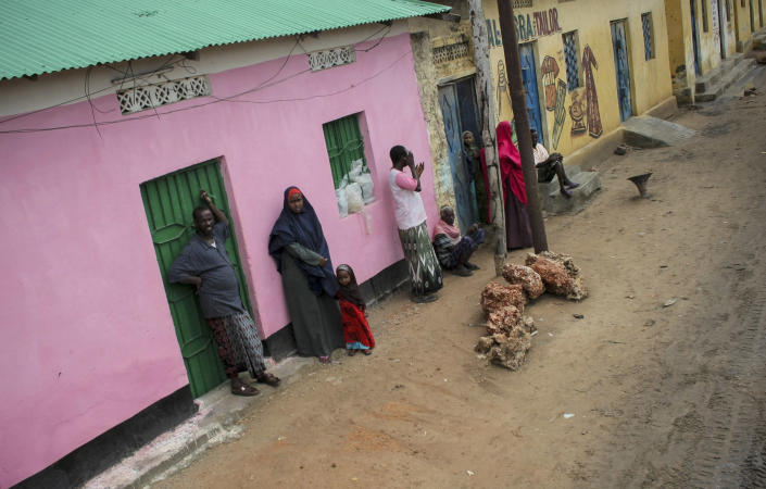 In this photo released by the African Union-United Nations Information Support Team, residents watch as a convoy of Kenyan soldiers serving with the African Union Mission in Somalia (AMISOM) passes by, in Kismayo, southern Somalia, Tuesday, Oct. 2, 2012. Allied African troops have taken full control of Kismayo in Somalia, the last stronghold of al-Shabab Islamist rebels who have been fighting against the country's internationally backed government, a Kenyan military official said Tuesday, and Kenya Defence Forces and the Somali National Army are now patrolling the streets. (AP Photo/AU-UN IST, Stuart Price)