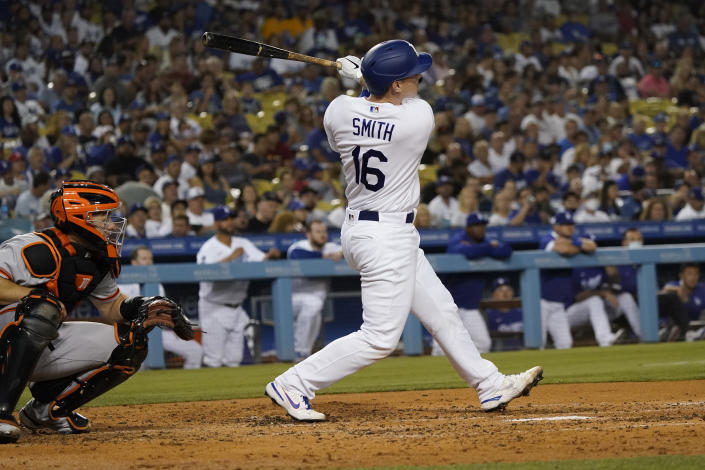 Los Angeles Dodgers' Will Smith follows through on his two-run home run during the fourth inning of the team's baseball game against the San Francisco Giants on Thursday, July 22, 2021, in Los Angeles. (AP Photo/Marcio Jose Sanchez)
