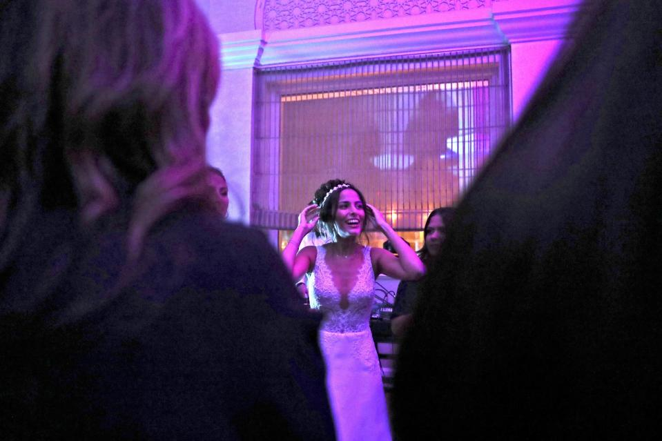 Israeli bride Noemie Azerad, reacts in her wedding party at a hotel in Dubai, United Arab Emirates, Thursday, Dec. 17, 2020. For the past month, Israelis long accustomed to traveling incognito, if at all, to Arab countries, have made themselves at home in the UAE's commercial hub. (AP Photo/Kamran Jebreili)