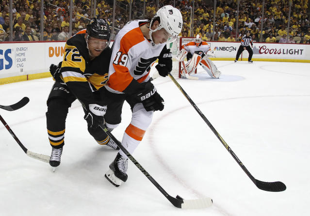 Pittsburgh Penguins' Patric Hornqvist (72) makes a pass around Philadelphia Flyers' Nolan Patrick (19) during the second period in Game 2 of an NHL first-round hockey playoff series in Pittsburgh, Friday, April 13, 2018. (AP Photo/Gene J. Puskar)