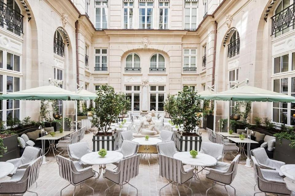 """<p><a href=""""https://www.booking.com/hotel/fr/de-crillon-paris.en-gb.html?aid=1922306&label=paris-hotels"""" rel=""""nofollow noopener"""" target=""""_blank"""" data-ylk=""""slk:Hôtel de Crillon"""" class=""""link rapid-noclick-resp"""">Hôtel de Crillon</a> is a celebration of the spirit of Paris, immaculately located just off Place de la Concorde with the Louvre, the Orangerie, the Orsay and the Centre Pompidou right on your doorstep. You're also close to the vast and glittering Opera building, with its frescoes, gilding, marble and candelabras. You can walk everywhere from this charming hotel, down classic esplanades and elegant parks, lined with gorgeous Renaissance buildings. </p><p>In fact, you're nothing short of being inside one. The hotel is housed in a historic landmark, a palace overlooking Place de la Concorde commissioned by Louis XV in the 18th century. You'll feel every bit the Queen of Versailles here, with breakfast served in the French Brasserie, drinks in the Ambassadors' Bar and delicate French pastry creations served in the Winter Garden. Plus, after a day of sightseeing, you can head down to the cozy relaxation area with its pool, steam room and infrared sauna and rest by the grand Himalayan salt wall. </p><p><a class=""""link rapid-noclick-resp"""" href=""""https://www.booking.com/hotel/fr/de-crillon-paris.en-gb.html?aid=1922306&label=paris-hotels"""" rel=""""nofollow noopener"""" target=""""_blank"""" data-ylk=""""slk:CHECK AVAILABILITY"""">CHECK AVAILABILITY</a></p>"""