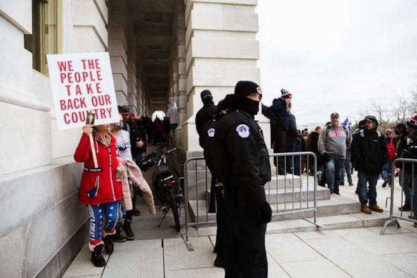 PHOTO: Member of a pro-Trump mob exit the Capitol Building after teargas is dispersed inside, Jan. 6, 2021, in Washington, D.C. (Jon Cherry/Getty Images)