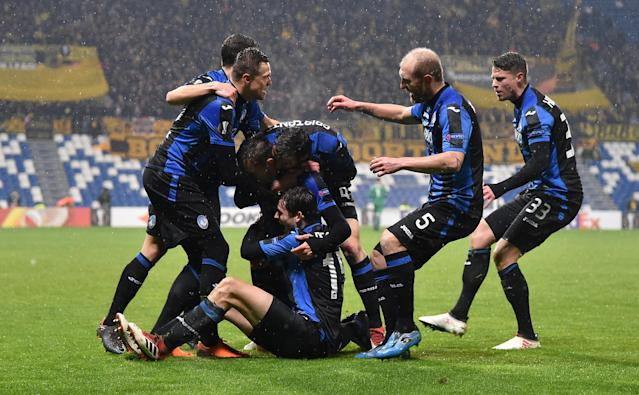 Soccer Football - Europa League Round of 32 Second Leg - Atalanta vs Borussia Dortmund - Stadio Atleti Azzurri, Bergamo, Italy - February 22, 2018 Atalanta's Rafael Toloi celebrates with team mates after scoring their first goal REUTERS/Alberto Lingria