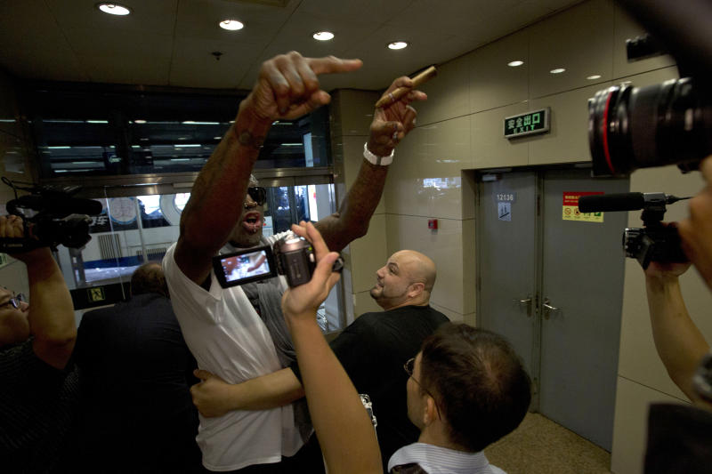 Retired NBA star Dennis Rodman, center, gestures as he reacts to a question about American citizen Kenneth Bae who remains imprisoned in North Korea, at the Beijing capital airport in Beijing, China, Saturday, Sept. 7, 2013. Rodman left North Korea Saturday, professing his affection for autocratic leader Kim Jong Un and angrily rejecting calls for him to lobby for the release of imprisoned American citizen Kenneth Bae. (AP Photo/Ng Han Guan)